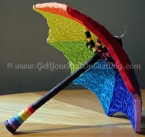 "<a href=""http://www.getyourrollonquilling.com/portfolio/le-parapluie-umbrella/""><b>Umbrella top to bottom</b></a>"